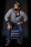 Young Bearded Man in Hat, Jeans, Shirt and Workers Boots Stock Photos