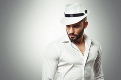 Young Bearded man with a hat posing in the studio Stock Photography