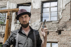 Young bearded man holding a gun Royalty Free Stock Images