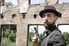 Young bearded man holding a gun Royalty Free Stock Photography