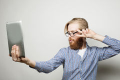Young bearded man holding tablet Royalty Free Stock Photo