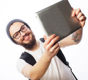 Young bearded man holding tablet Royalty Free Stock Image
