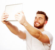 Young bearded man holding tablet Royalty Free Stock Photos