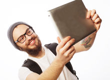 Young bearded man holding tablet Stock Photos