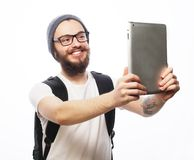 Young bearded man holding tablet Stock Photography