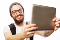 Young bearded man holding tablet Royalty Free Stock Photography