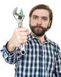 The young bearded man a holding wrench in hand Stock Images