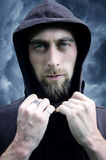 Young bearded man in the hood Stock Images