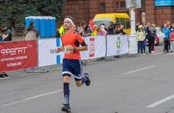 Young bearded man hurrying to finish line during `Dnepr Eco Marathon` race. DNEPR, UKRAINE - SEPTEMBER 25, 2016:Young bearded man hurrying to finish line during stock photo