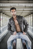 Young bearded man with jacket on naked torso Royalty Free Stock Image