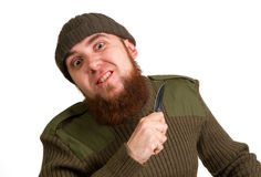 A young bearded man with a knife Stock Photography