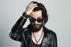 Young bearded man in leather. Hipster in sunglasses Royalty Free Stock Photography