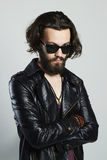 Young bearded man in leather. Hipster in sunglasses Stock Photos
