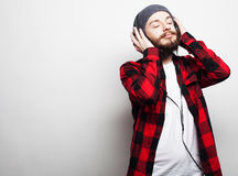 Young bearded man listening to music Royalty Free Stock Images