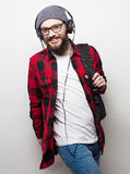 Young bearded man listening to music Stock Photography