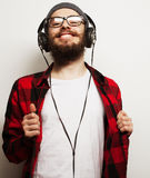 Young bearded man listening to music Royalty Free Stock Image
