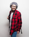 Young bearded man listening to music Stock Image