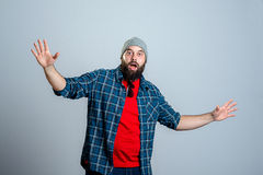 Young bearded man lokking amazed Stock Photos