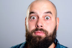 Young bearded man lokking amazed Royalty Free Stock Photos