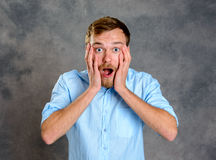 Young bearded man lokking amazed. In to the camera Stock Photos