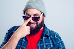 Young bearded man looking friendly Stock Image
