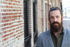 Young bearded man with man bun and a very nice and clean skin with copy space on the left side of the photography Stock Images