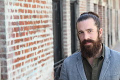 Young bearded man with man bun and a very nice and clean skin with copy space on the left side of the photography Stock Image