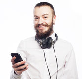 Young bearded man with mobile Royalty Free Stock Images