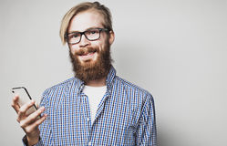 Young bearded man with mobile phone Stock Photography