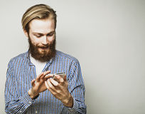 Young bearded man with mobile phone Royalty Free Stock Photography