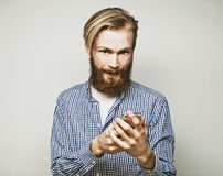 Young bearded man with mobile phone Royalty Free Stock Photos