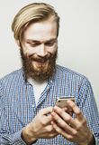 Young bearded man with mobile phone Stock Image