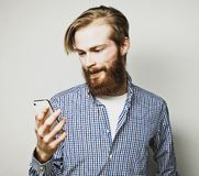 Young bearded man with mobile phone Royalty Free Stock Images