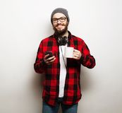 Young bearded man with mobile phone Royalty Free Stock Photo