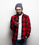 Young bearded man with mobile phone Stock Photos