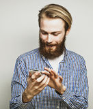 Young bearded man with mobile phone Stock Images