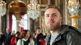 Young, bearded man in the museum stock footage