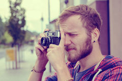 Young bearded man with old camera Stock Image