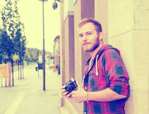 Young bearded man with old camera Stock Photos