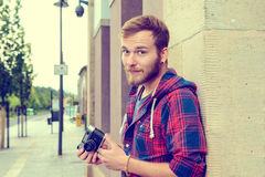 Young bearded man with old camera Royalty Free Stock Photography