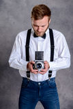Young bearded man with old camera Royalty Free Stock Photo
