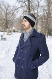 Young bearded man in a park on a winter day Royalty Free Stock Photo