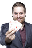 Young bearded man playing with cards Royalty Free Stock Image