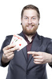 Young bearded man playing with cards Royalty Free Stock Images