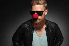 Young bearded man with red clown nose Stock Photography