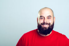Young bearded man in red shirt Stock Images
