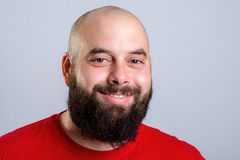 Young bearded man in red shirt Royalty Free Stock Image