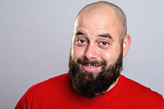 Young bearded man in red shirt Royalty Free Stock Photos