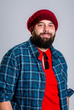 Young bearded man with red woolen cap Stock Photo