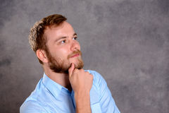 Young bearded man is reflecting Royalty Free Stock Images
